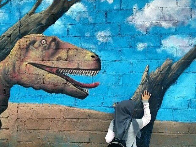 Spot foto mural dinosaurus